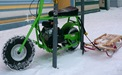 mini-bike tied to bike rack