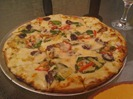 Roman Holiday pizza at Pizzeria 201 in Montgomery, MN