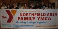 NHS DECA club creates a sign for the Northfield YMCA