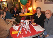 Friends of the Library president Bill North (donating), Sue Lloyd,  Peggy Kelly, Steve Kelly, Betsey Spethmann, Tim Lloyd ,