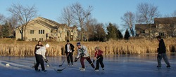 Pond hockey in Hidden Valley Park, Northfield