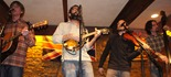 Aaron Hagenson, Vocals & Guitar; Jake Stroup, Vocals & Mandolin; Aaron Cross, Fiddle & Vocals; Carl Haskins, String Bass