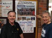 Northfield Activities Director Tom Graupmann and Assistant Coach Griff Wigley with MTB poster at Northfield High School