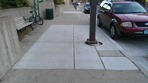 new sidewalk devoid of poety