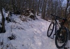regular mountain bike on a trail with moderate snow, not packed: difficult