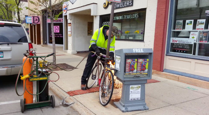 Video: A bicycle locked to a parking sign in downtown Northfield gets forcibly removed