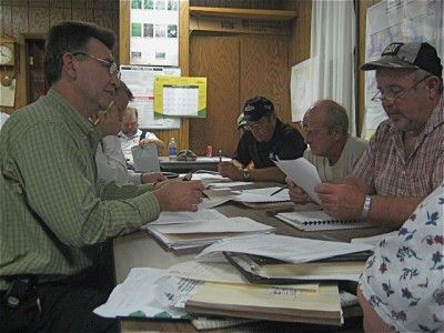 Photo: Bonnie Obremski/RepJ Caption: Joel Walinski, Northfield's interim city administrator faces Richard Moore, Greenvale township's superisor chairman on September 16. Jody Gunderson, representing Northfield's Economic Development Authority, sits beside Walinski. Beside Moore are supervisors Bernard Budin and Robert Winter.