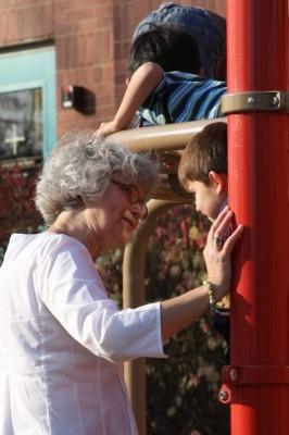 Photo by Joshua Rowan Barbara Howe plays with children at Open Door Nursery School.