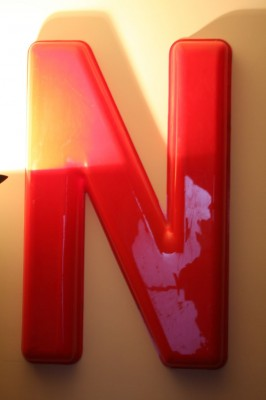 "Photo by Josh Rowan A letter ""N,"" once part of a downtown supermarket sign, now stands for NTV in the entryway of the station."