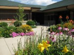 The Northfield Senior Center courtyard, decorated with a new flower arrangement by America in Bloom, Northfield