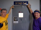 Griff Wigley and Kyle Snesrud outside the OH! Dale! racquetball court at the Northfield Athletic Club