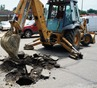 Repairs to deep street hole at 6th & Division