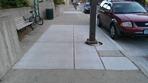 new sidewalk devoid of poety