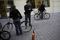 cop and bicyclists